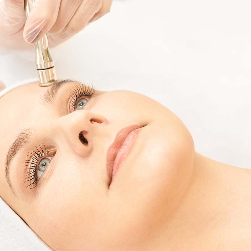 Cosmetology face treatment. Patient young girl. Salon cosmetic hardware. Dermatology diamond skin clean